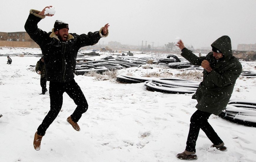 Free Syrian Army fighters play with snow in Raqqa